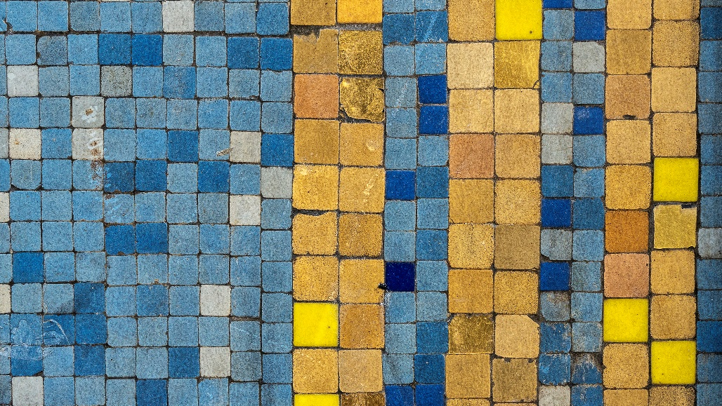Ancient blue, brown, and yellow mosaic tiles