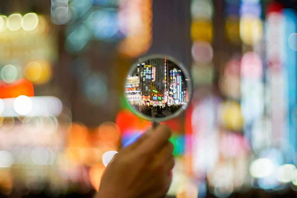 City lights focused in magnifying glass